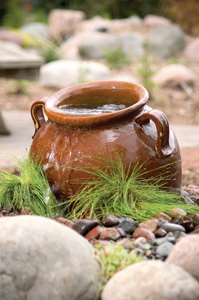 Ceramic Slanted Jar Fountain in a garden